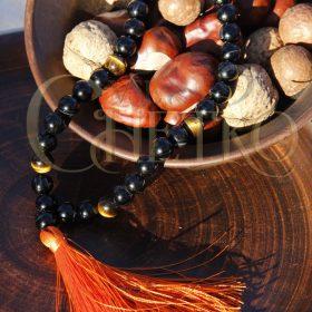 Четки из черного агата и тигрового глаза 33 бусины оранжевая кисточка