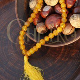 Четки из желтого (медового) агата на 33 бусины 10 мм с желтой кисточкой