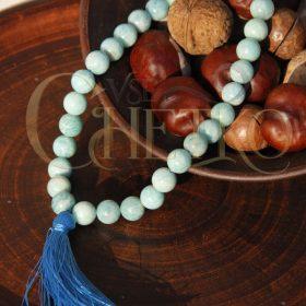 Четки из амазонита на 33 бусины шарика 10 мм с голубой кисточкой
