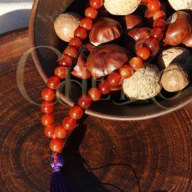 Четки из сердолика, 33 бусинки шарика 10 мм с фиолетовой кисточкой