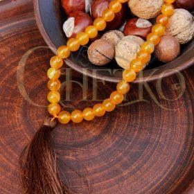Четки с коричневой кисточкой, из желтого, медового агата на 33 бусины 10 мм
